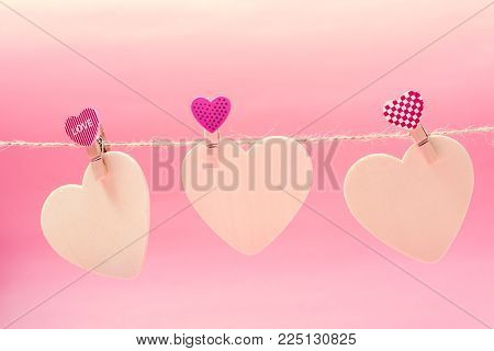 White hearts with clothes pegs hanging on string, Valentine concept