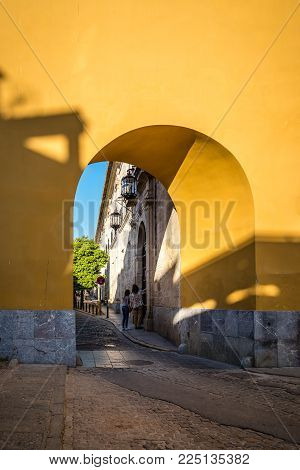 Cordoba, Spain - April 10, 2017: Arch in yellow wall in Caballerizas Reales Street in Cordoba