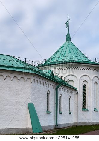 Part of the architectural complex Ratnaya Chamber with a turret, a facade, a spire, a three-headed eagle on a spire against a blue sky in Tsarskoye Selo in Alexander Park St. Petersburg, Russia