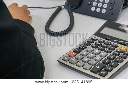 close up accountant desk with  phone and calculator