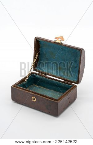Vintage luxury wooden box with gold lock and handle isolated on white background