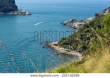 Beach with cliffs in the Palmaria and Tino island (Isola di Palmaria e di Tino) in the Gulf of La Spezia near Porto Venere, Liguria, Italy, Europe