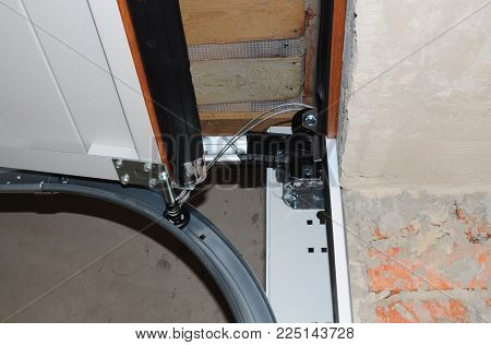 Contractor  Repair And Install Garage Door. Replace A Broken Garage Door Spring. Garage Door Spring