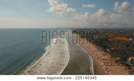 Aerial view of beautiful beach, hotels and tourists, Bali, Kuta. Beautiful view nice tropical beach from the air. Seascape, beach, ocean, sky sea , Travel concept