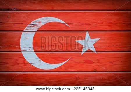 Flag of Turkey on red wooden background