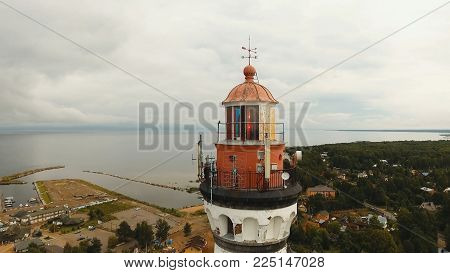 Ancient lighthouse on the coast of the sea, the lake. Aerial view Landscape of Monumental Lighthouse.