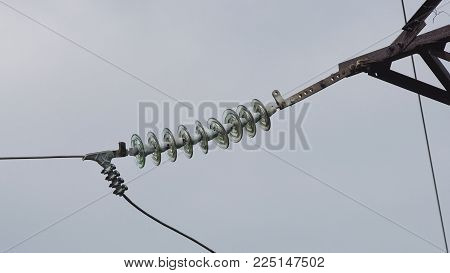 High voltage post.High-voltage tower sky background. High-voltage electrical insulator electric line against the blue sky. Electricity transmission power lines.