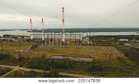 Aerial view Hydroelectric power station, transformation station, cables and wires. High voltage electric power substation. Electrical power transformer in high voltage substation.