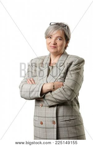 Mature businesswoman looking at camera, isolated on white background.
