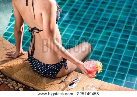 Portrait Beautifu Woman Relaxing In Big Hat And Bikini Sitting Back On Air Mattress In Swimming Pool