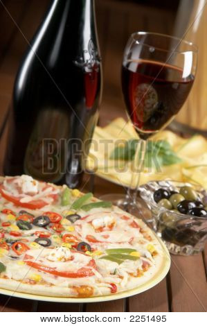 Still Life With Red Wine And Pizza