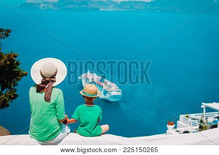 mother and son looking at Santorini, Greece, travel concept