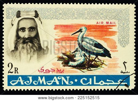 Moscow, Russia - February 05, 2018: A stamp printed in Ajman shows Sheik Rashid and White Stork (Ciconia ciconia), series