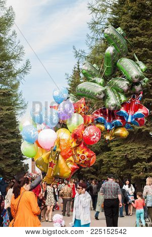 Ufa, Russia - May 9, 2017 a Person sells large balloons in the Park, the celebration, the victory day