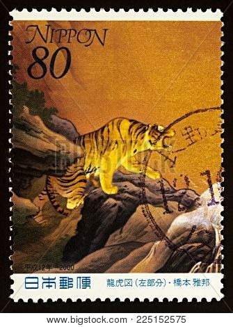 Moscow, Russia - February 05, 2018: A stamp printed in Japan shows painting of tiger by Japanese artist Hashimoto Gaho (1835-1908), series