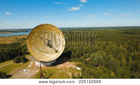 Radio astronomy observatory located in the forest. Aerial view Giant radio telescop, Large satellite dish.drone footage.