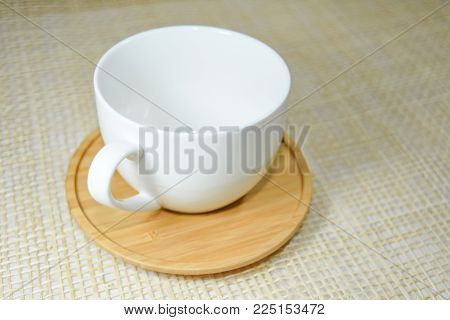 White Cup On Wooden Plate And Background For Use In Coffee Shop,white Cup For Use In Coffee Shop
