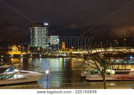 COLOGNE, GERMANY - FEBRUARY 21, 2016: Night view of embankment in Cologne, the largest city in the German federal State of North Rhine-Westphalia and the fourth-largest city in Germany