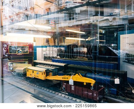 PARIS, FRANCE - JAN 30, 2018: Store window facade selling multiple toy collectible model trains featuring all railways in the world in central Paris, France