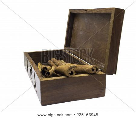 Cinnamon in wooden asian tea box isolated on white background