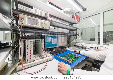 Zelenograd, Russia - October 19, 2017: The engineer conducts a test of the finished electronic modules. Laboratory for testing and adjustment of electronic equipment.