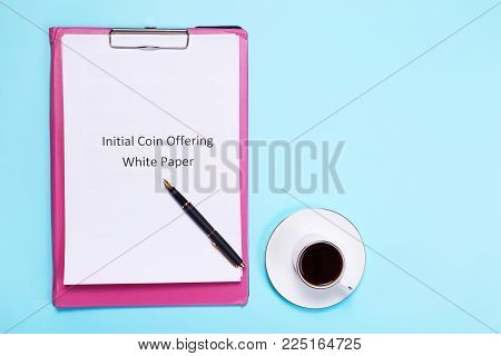 Initial coin offering White paper is one of the main documents for the ICO. A cup of fragrant coffee on the table. There is space for your text here.