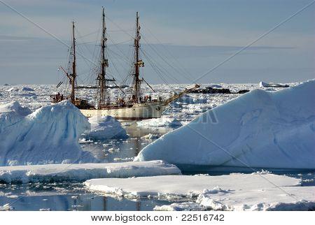 Sailing Ship Among The Icebergs