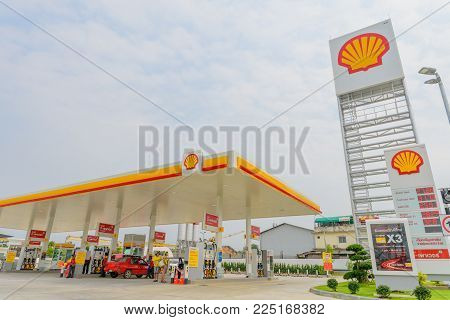 Pattaya, Chonburi, Thailand - Feb 3, 2018: Shell gas station blue sky background during sunset. Royal Dutch Shell sold its Australian Shell retail operations to Dutch company Vitol in 2014