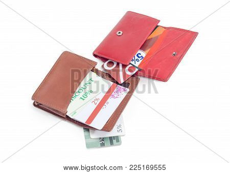 Discount cards in open red leather wallet, in brown leather special wallet for cards and several cards separately beside on a white background