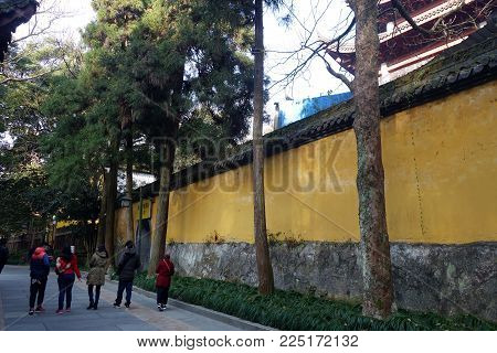 HANGZHOU, CHINA-JAN 08, 2018: Tourists walk along in the Lingyin Temple (Temple of the Soul's Retreat) in Hangzhou, China. One of the largest Buddhist temples in China