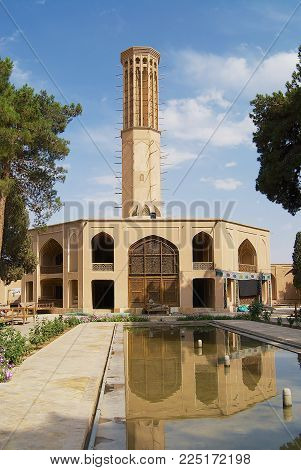 YAZD, IRAN - JUNE 17, 2007: Exterior of the Dowlatabad building in Yazd, Iran. Dowlatabad has the highest badgir - wind catching tower in the world.