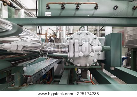 The frosted head of the compressor of the refrigerating machine. Industrial freezer.