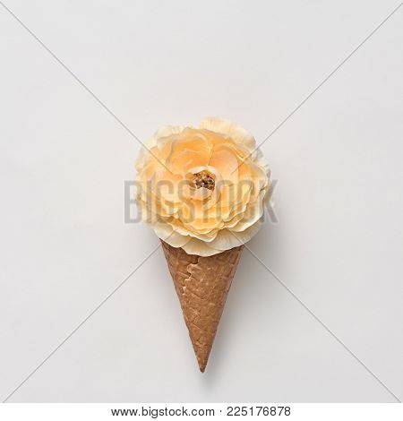 Ice Cream Cone with Yellow Flower. Creative Minimal. Yellow Rose, Vanilla Color. Spring Summer Floral concept. Trendy fashion Style. Art Vintage