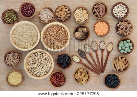 Macrobiotic diet health food concept with cereals, grains, legumes, seeds, wasabi nuts, seaweed, whole wheat pasta and vegetables with foods high in fibre, antioxidants and minerals.