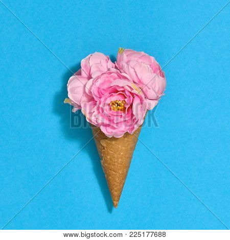Ice Cream Cone with Bouquet of Flowers. Trendy fashion Style. Spring Summer Floral concept. Creative Minimal. Pink Roses, Bright Color. Art Vintage
