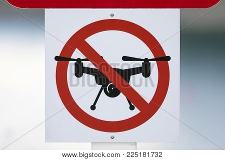 Drones Prohibited/ No Fly Zone Sign On Post