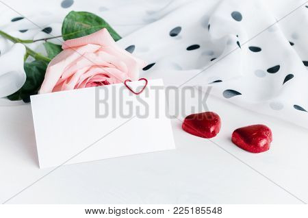 Romantic St Valentines Day Background. Rose, Blank Love Card And Two Heart Shaped Candies. Romantic