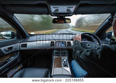 Rural Car Drive with External Blur, and Car in motion creating dynamic action, from the interior in the daytime