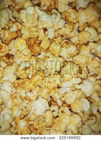 photo tender yellow appetizing popcorn grains close-up.