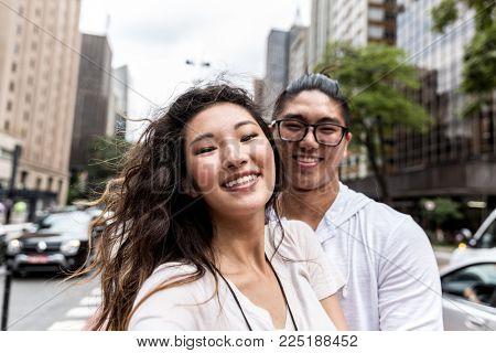 Self Portrait of Young Asian Couple in Paulista Avenue, Sao Paulo, Brazil