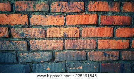 background of grease stains on bricks wall of a garage in vintage style