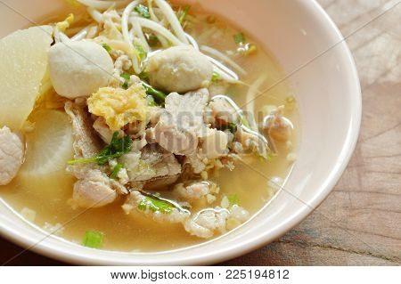 boiled slice pork and ball with bean sprout in clear soup on bowl