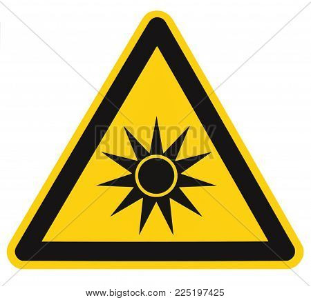 Optical radiation hazard caution safety danger warning text sign sticker label, artificial light beam icon symbol, isolated black triangle over yellow, large macro closeup
