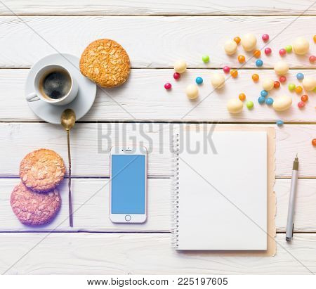 LONDON, UK NOVEMBER 27, 2017: Top view of sweet morning scene with coffee, diary and iphone. Clipping path