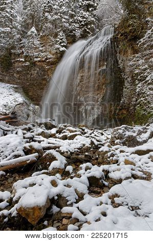 Waterfall landscape in winter of French Alps