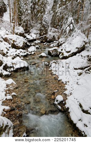 River and snow for a winter landscape of French Alps