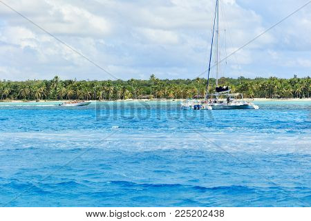 Speedboat with tourists on secluded beach on Saona Island, La Romana, Dominican Republic