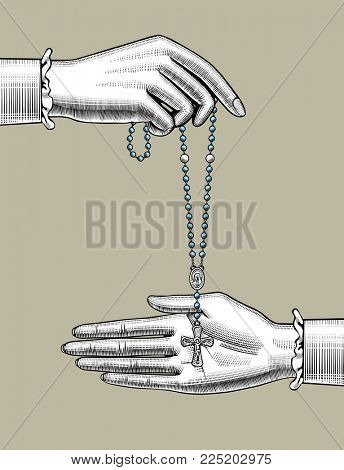 Woman's hands with catholic prayer beads. Vintage engraving stylized drawing