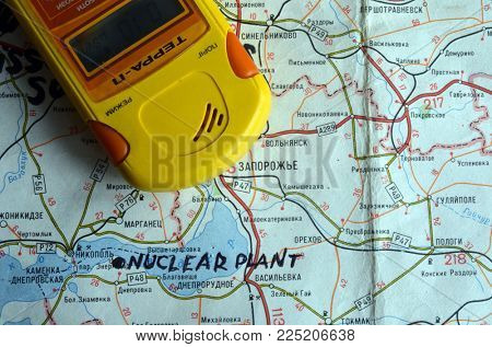 ILLUSTRATIVE EDITORIAL. Modern Ukrainian  geiger counter Terra-P. Back - Map with location NPP in Energodar.Kiev,Ukraine.February1, 2018