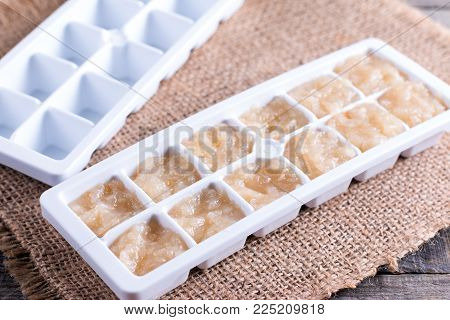 Puree from pears in a mold for freezing